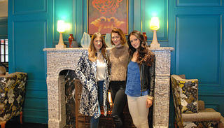 The cast of Mercy Street pose in front of the fireplace in the Monaco Alexandria Hotel