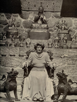 Portrait of Jacques Marchais sitting with her artifacts