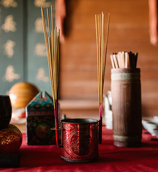 Incense sticks on the alter of the Kwan Tai Temple in Mendocino, California