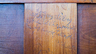 Hand carvings on pew boxes in Prince George Winyah Episcopal Church.