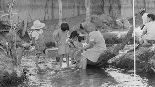 Evacuees in the creek that flows along the border of Manzanar