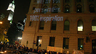 An illumination on a building as part of a climate change protest.