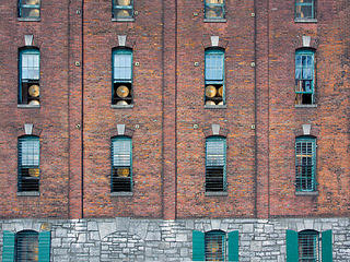 View of Buffalo Trace Distillery's barrels through windows.