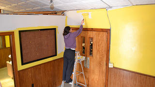 Sarina painting the church interior yellow