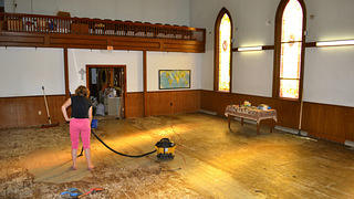 Sarina's mother works on the church floors
