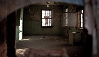 Interior of Crownsville State Hospital through a broken window