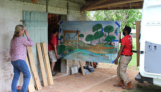 Moving the murals from the van into the African house