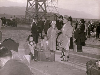 Families gather with their suitcases