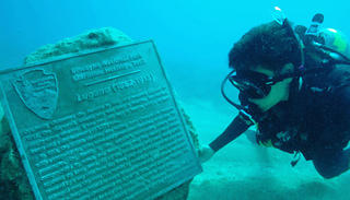Conor Knighton scuba diving near Lugano wreck marker