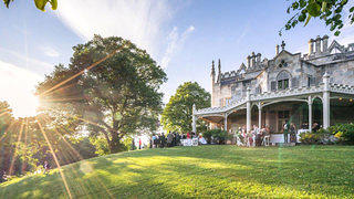 Lyndhurst Mansion Veranda at sunset during a cocktail wedding reception