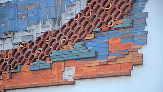 Painted blue and natural bricks of the mural. Credit: David Olivera/RLA Conservation