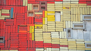 Painted red and yellow bricks. Credit: David Olivera/RLA Conservation