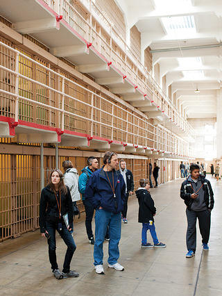 Visitors tour the inside of the prison