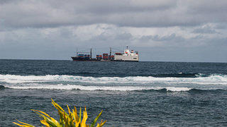 Freight ships bring food thousands of miles from its point of manufacture to the island's grocery stores.