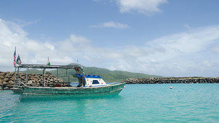 A boat—the only connection between Aunu'u and Tutuila—awaits passengers in Aunu'u.