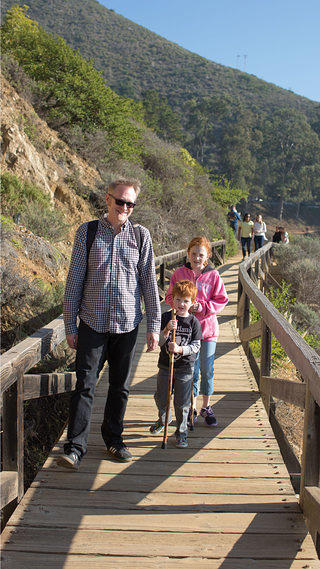 Bill Forbes and family at waterfall overlook