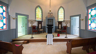 Torah and stained glass windows at Temple Beth El in Camden, South Carolina.