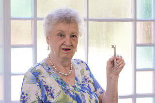 Member Helen Hendrix holds McBee Methodist Church's original key. Credit: Bill Fitzpatrick