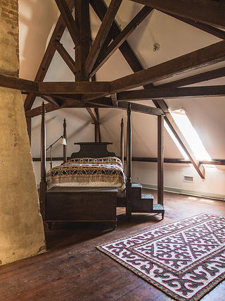 Bedroom with vaulted ceilings and exposed trusses