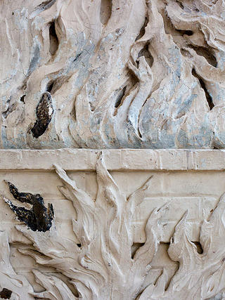 Detail shot of the plaster bas relief flames