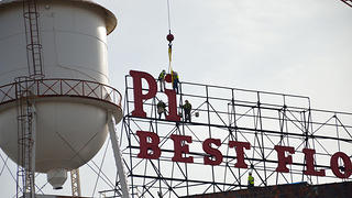 Pillsbury sign being reinstalled