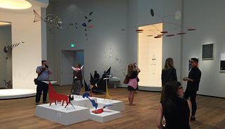 Social media influencers explore the Calder room in Tower 2 of the reopened NGA East Building
