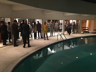 Attendees at the Weinrib House reception enjoy the 1962 Keck and Keck design, including a swimming pool with a retractable roof.