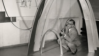 Architect Eero Saarinen with a model of the Gateway Arch in St. Louis