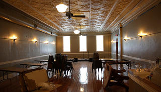 The second-story ballroom of Worth Brewing Company, now an event space, has its original tin ceiling.