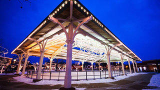 The outdoor ice rink at Manssas Virginia borders a 200-year-old train depot