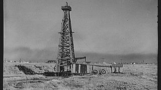 A black and white photograph of an oil well at Borger, near Amarillo, Texas.