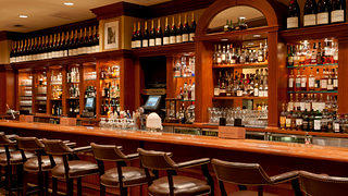 The long wooden bar at The Last Hurrah at the Omni Parker House in Boston