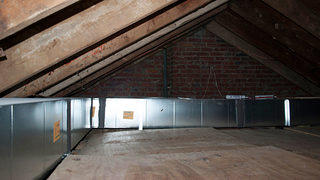 Brand new ductwork circles around the perimeter of the attic at Dumbarton