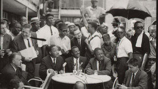 a photo of the truce between black and white leaders of Birmingham, held in the courtyard of the A.G. Gaston Motel