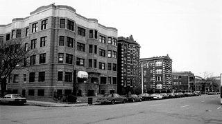 A historic photograph of a middle-class neighborhood in Detroit with apartment buildings.
