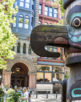 Totem pole and Pioneer Building in Pioneer Square