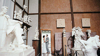 A couple takes photos in the sculpture room  inside Chesterwood.