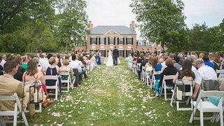 An outdoor wedding ceremony takes place at historic Woodlawn in Virginia.