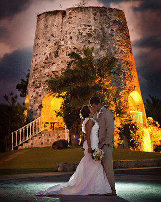 A couple shares an intimate moment outside The Buccaneer's historic, 1733 sugar mill.