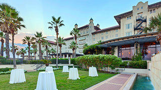 Outdoor wedding venues at Hotel Galvez & Spa, located in Galveston, Texas, show off its classic, turn-of-the-century charm.