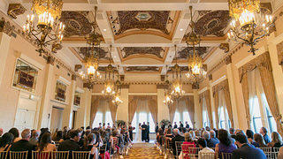 Classic, elegant ballrooms with ornate ceiling detail sets the historic Pfister Hotel in Milwaukee, Wisconsin apart from the wedding venue crowd.