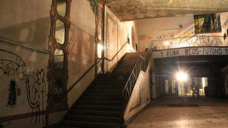 At one point in its history, the theater's murals were painted over. After the building closed in 1993, it succumbed to vandalism and fell into disrepair.