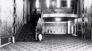 "The floor-to-ceiling, silver leaf murals in the theater's lobby featured Greek gods and goddesses donning ""updated"" clothing popular during the 1920s."