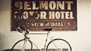 The original sign of the Belmont Motor Hotel promises skyline views of Dallas.