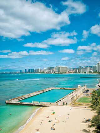 Kaimana Beach, the Natatorium, and Honolulu's skyline.