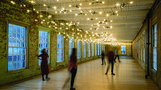 The interior of Building 8 at MASS MoCA features a long term exhibit by Spencer Finch.