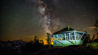 The stars are illuminated behind a lookout at night. Credit: Ethan Welty