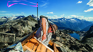 A man works on repairing a lookout roof. Credit: Ethan Welty