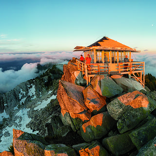 A lookout on a mountain peak above the clouds. Credit: Ethan Welty