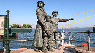 Statue of Annie Moore and her two brothers, the first immigrants to be registered at Ellis Island.